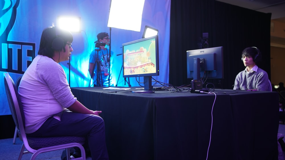 two men playing a video game