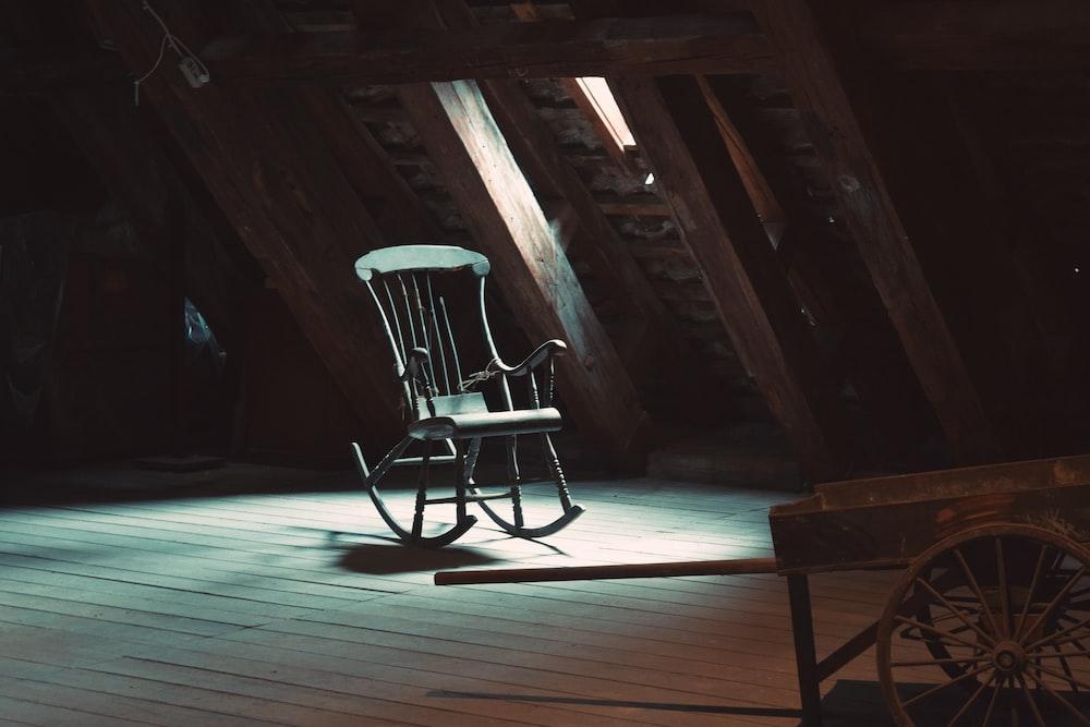rocking chair on attic near window