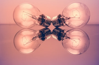 two clear light bulbs creativity zoom background