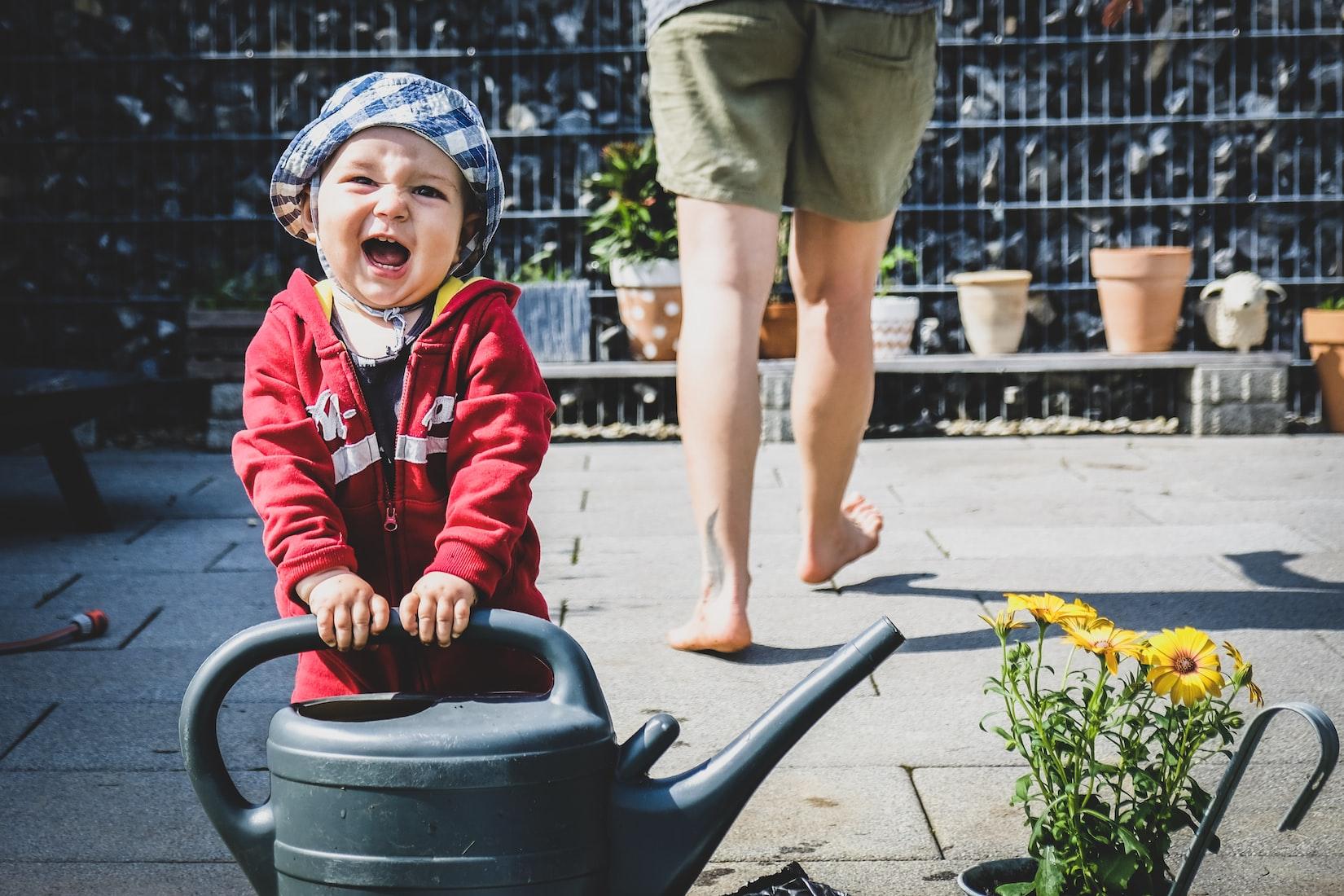 kid watering flower