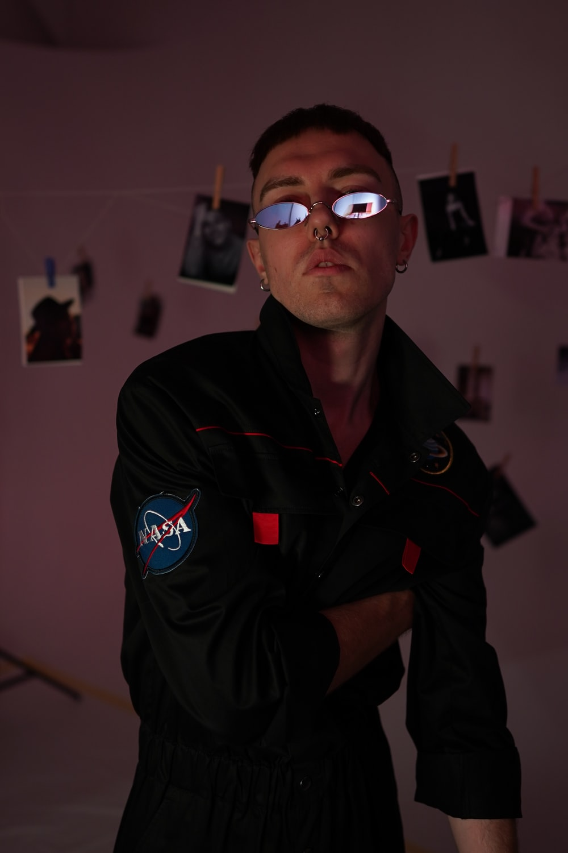 man in black jumpsuit standing inside room