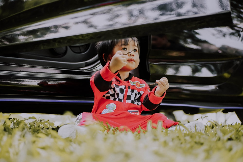 baby wearing red pajama set