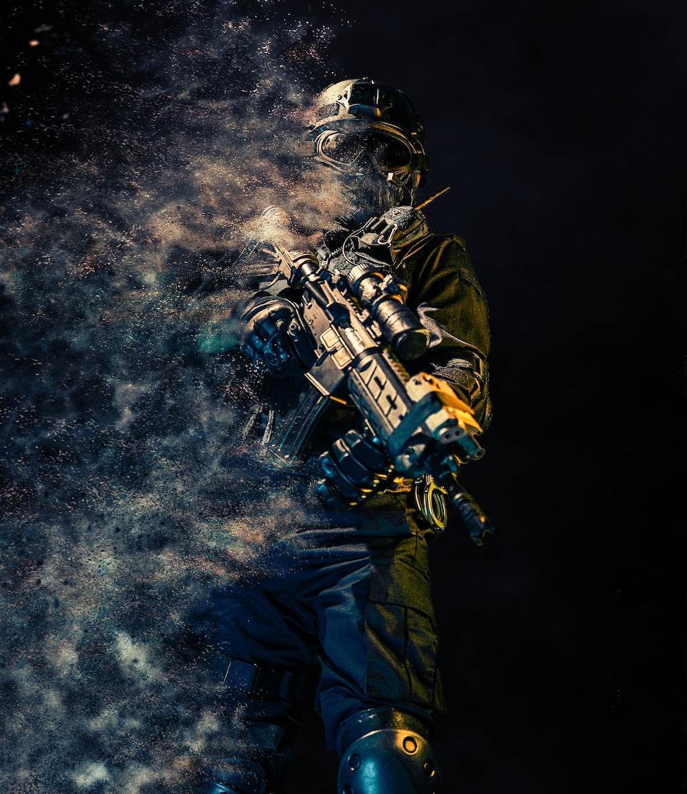man holding rifle wallpaper