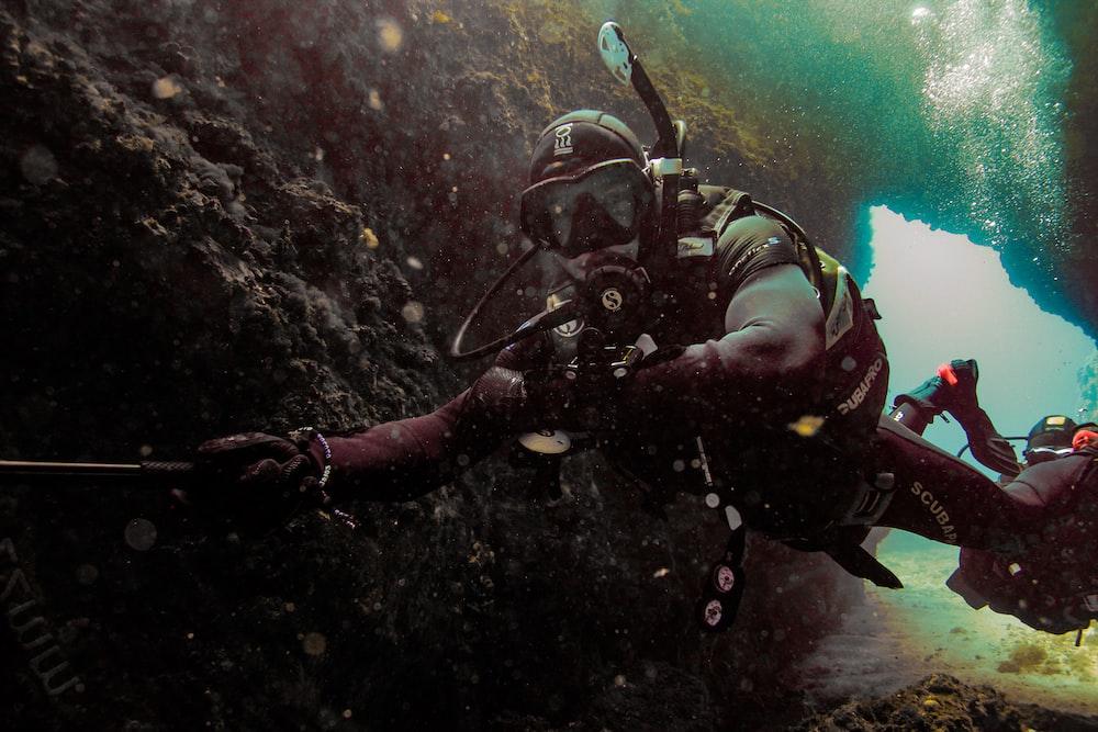 man surfing under water