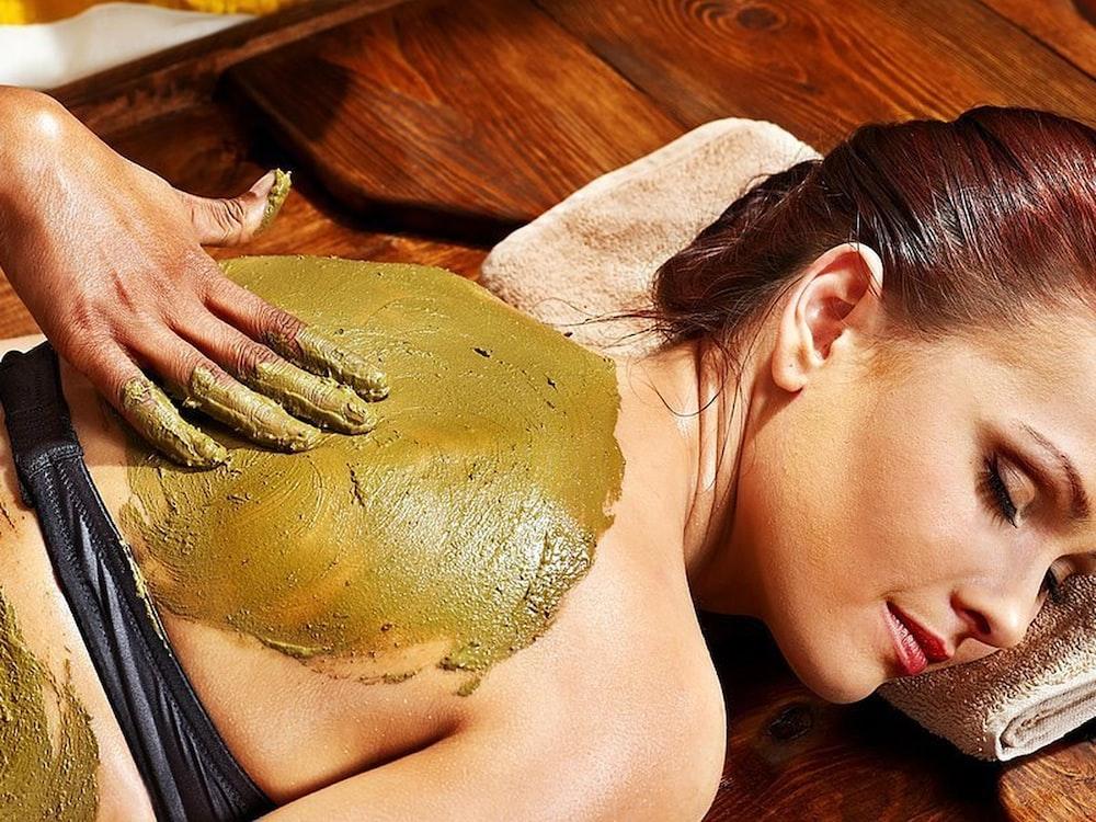 person massaging a women close-up photography