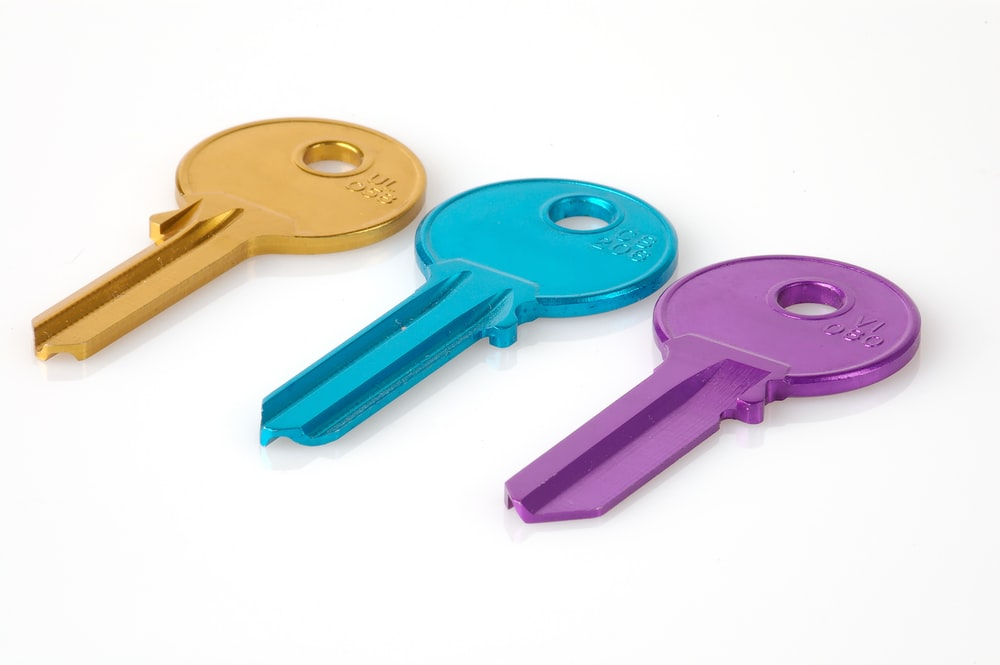 three assorted-color keys