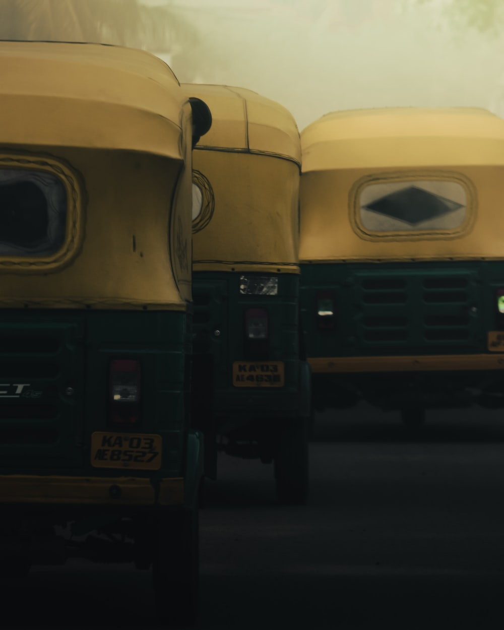 three yellow auto-rickshaws