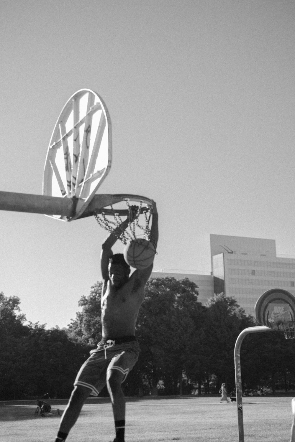 grayscale photography of man playing basketball
