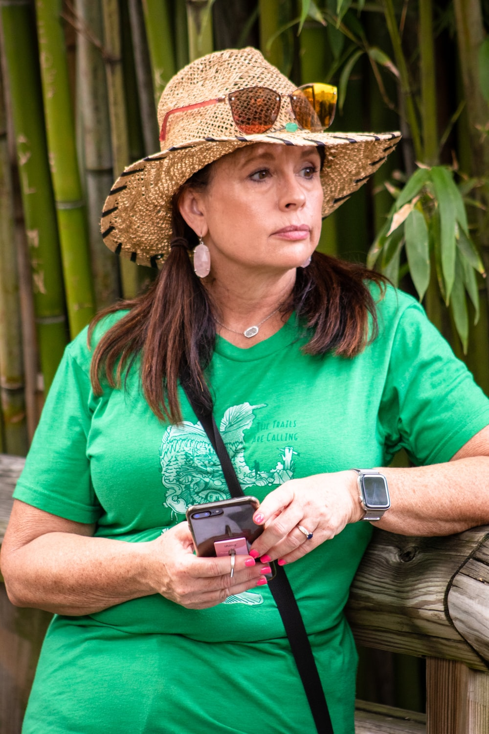 woman green shirt and hat