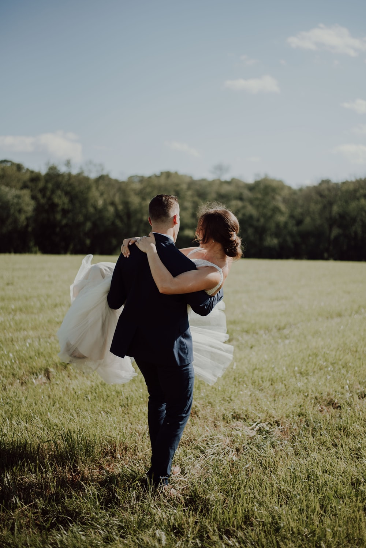 man carrying woman during daytime