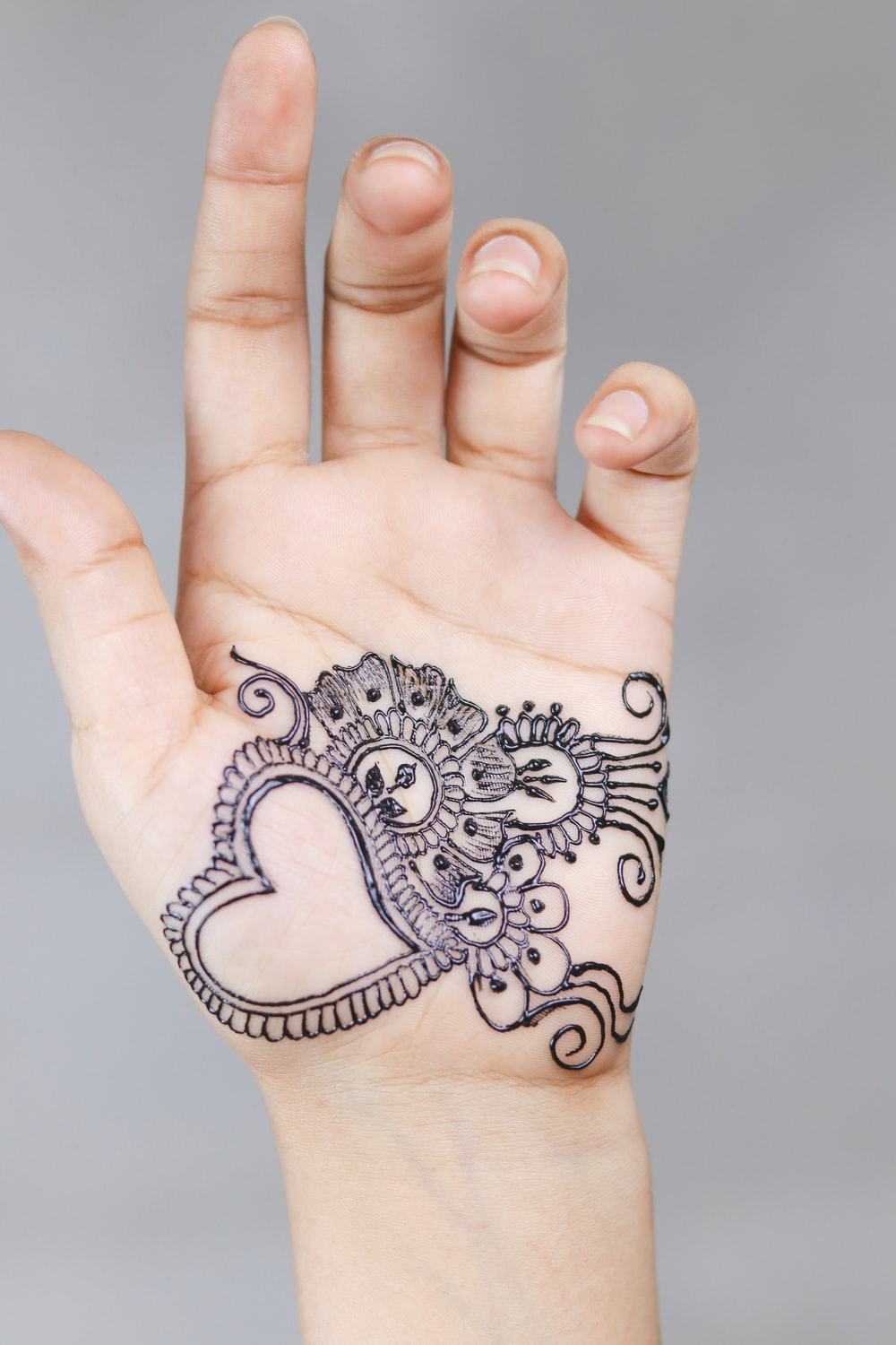left person's hand with tattoo