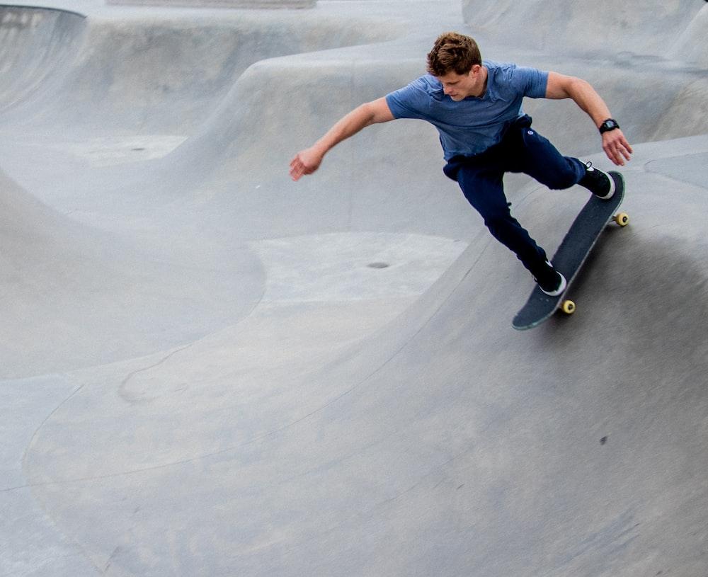 man skateboarding on ramp