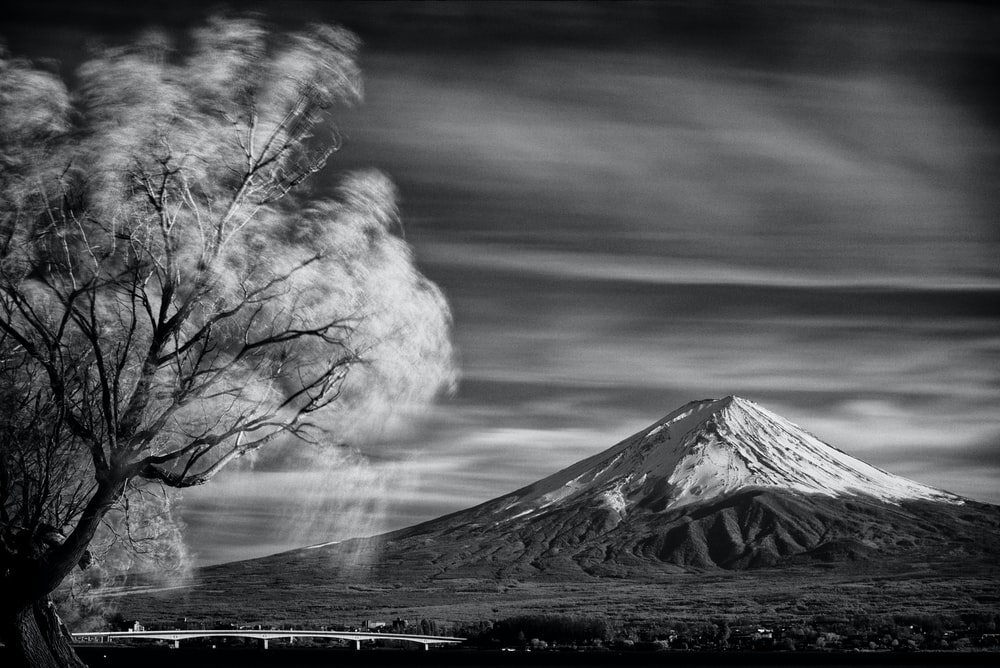 snow covered mountain black and white photo