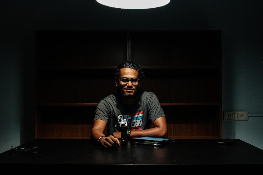 man sitting front of desk