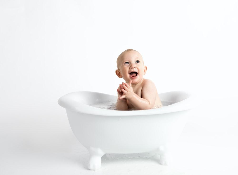 boy in bathtub bathing