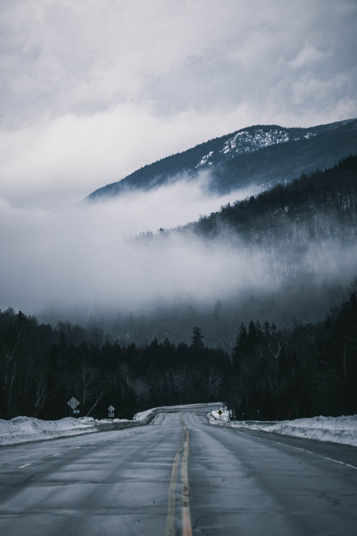 black concrete road near mountain
