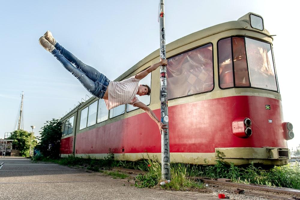 man performing parkour near train