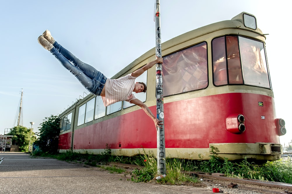 man performing parkour near train