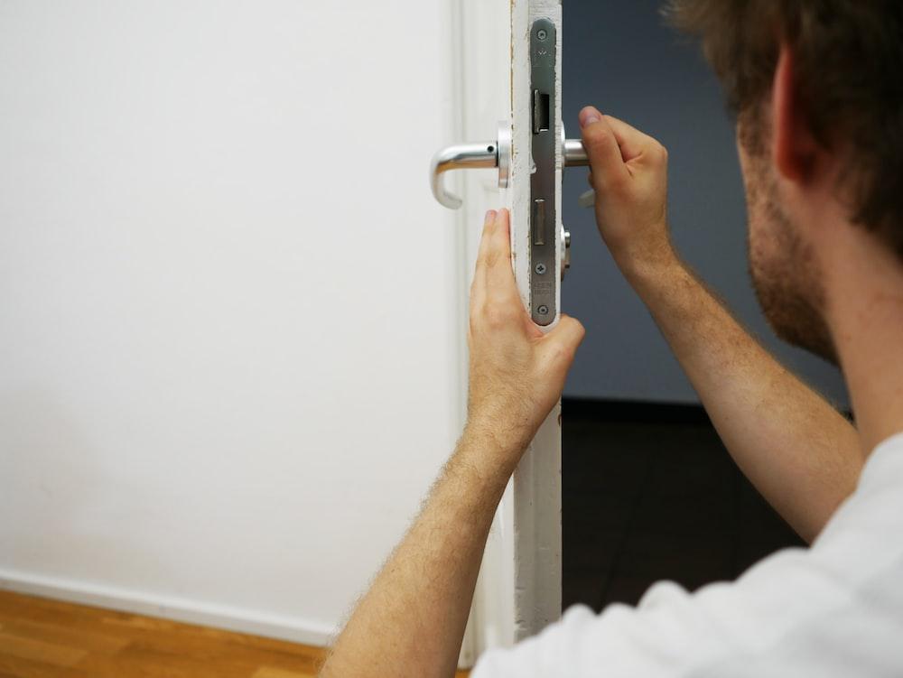 person holds door lever