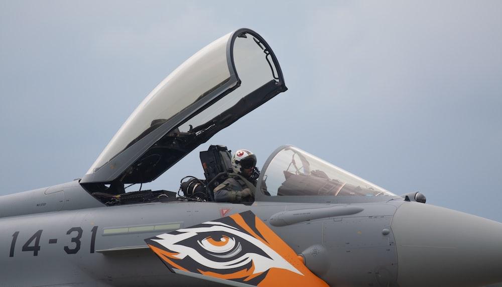 gray and orange fighter plane