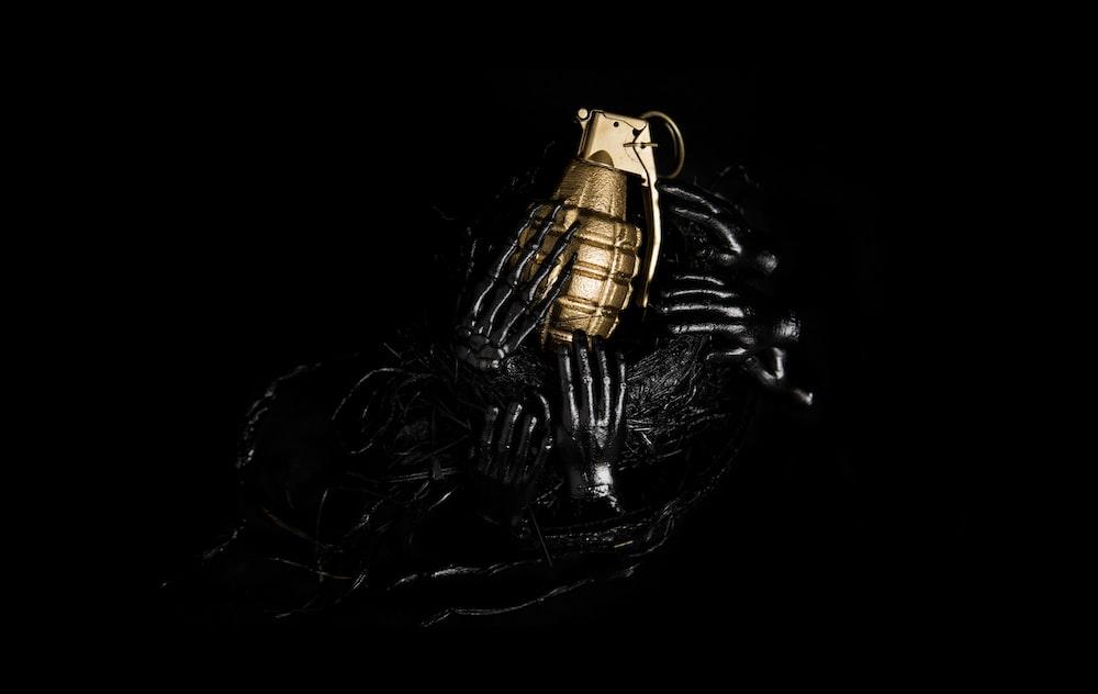 gold-colored hand grenade decor