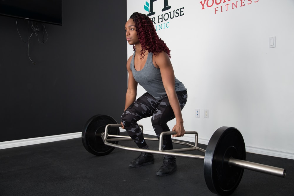 woman about to lift barbell
