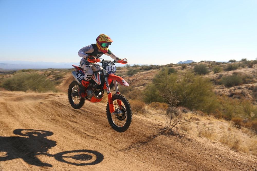 man drives motocross bike downhill