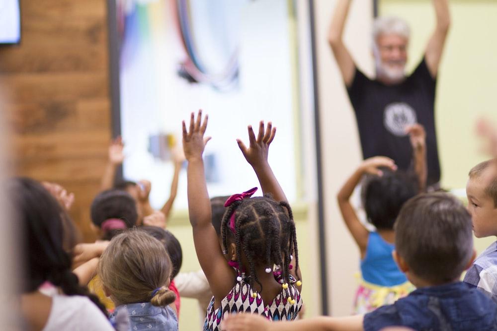 children lifting hands