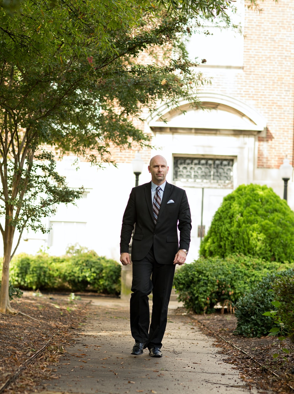 man standing on pavement