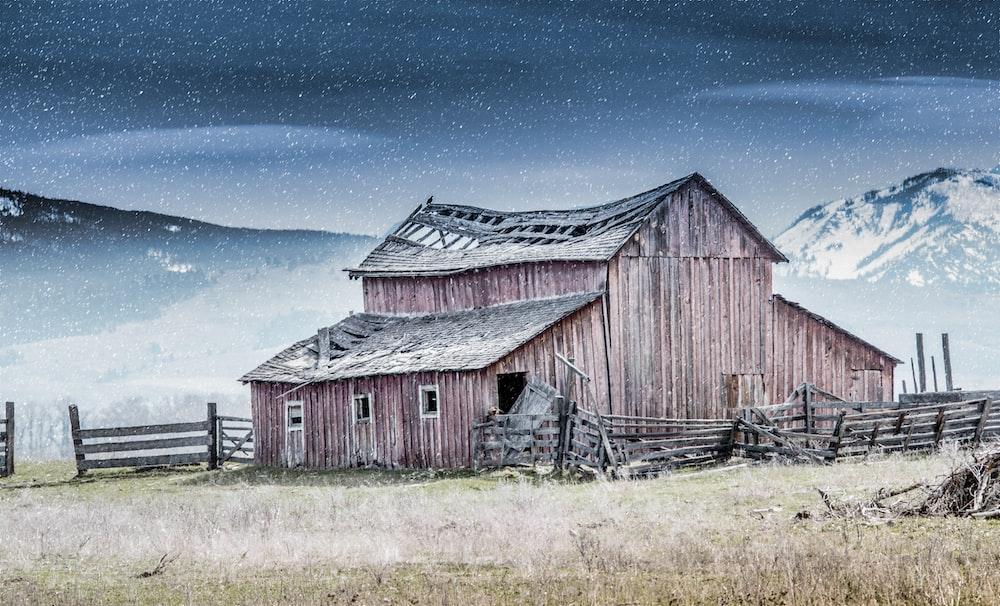 brown barn house under blue sky