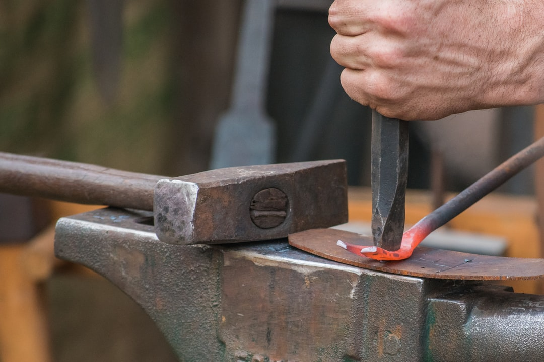 A piece of metal being forged into a crowbar at the Blacktown City Medieval Fayre in New South Wales, Australia.