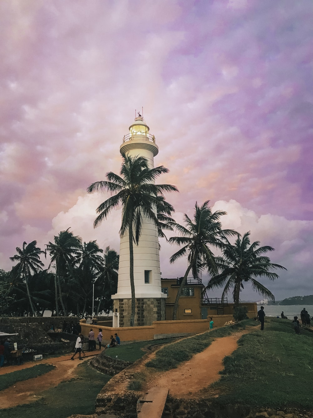 lighthouse tower under cloudy sky