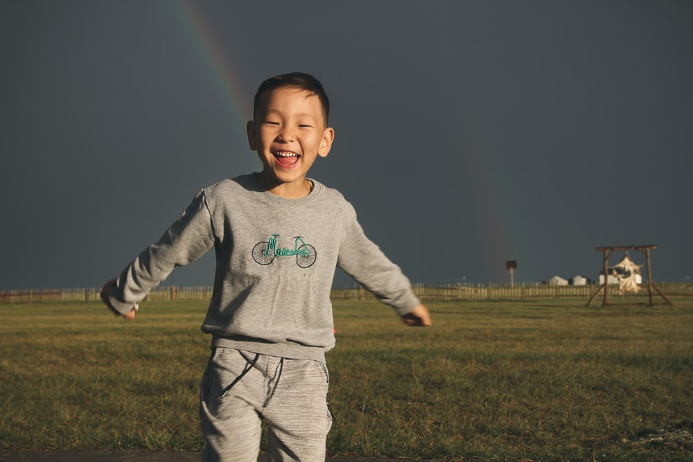 boy on grass field