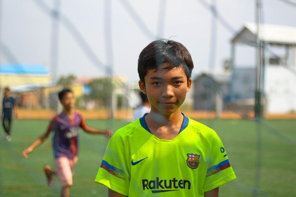 boy standing near net goal