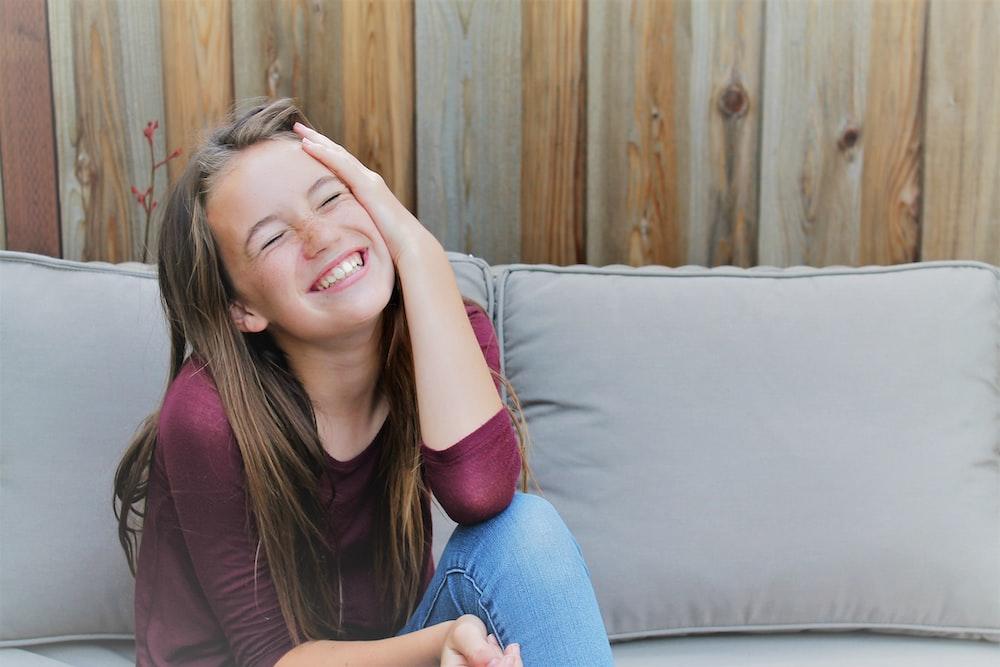 girl sitting on sofa