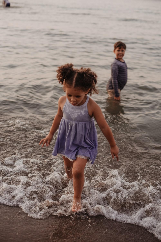 girl wearing blue sleeveless dress on seashore