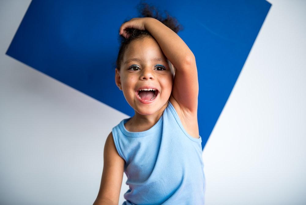 boy wearing blue tank top