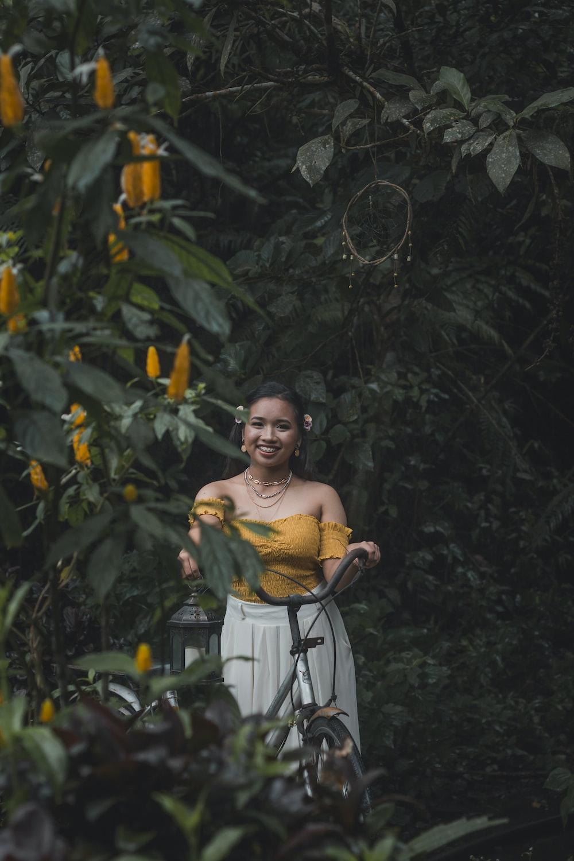 smiling woman near flower plants