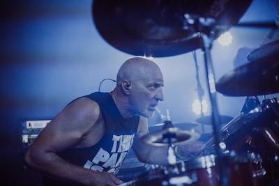 man playing drum instrument