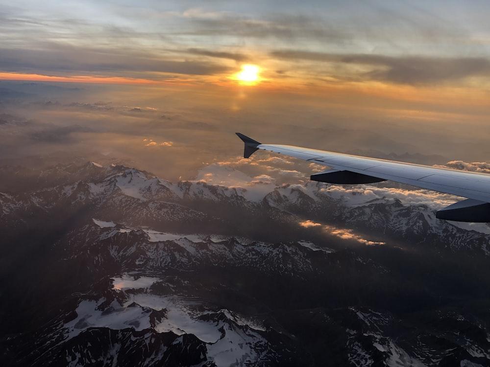 passenger plane flying under golden hour