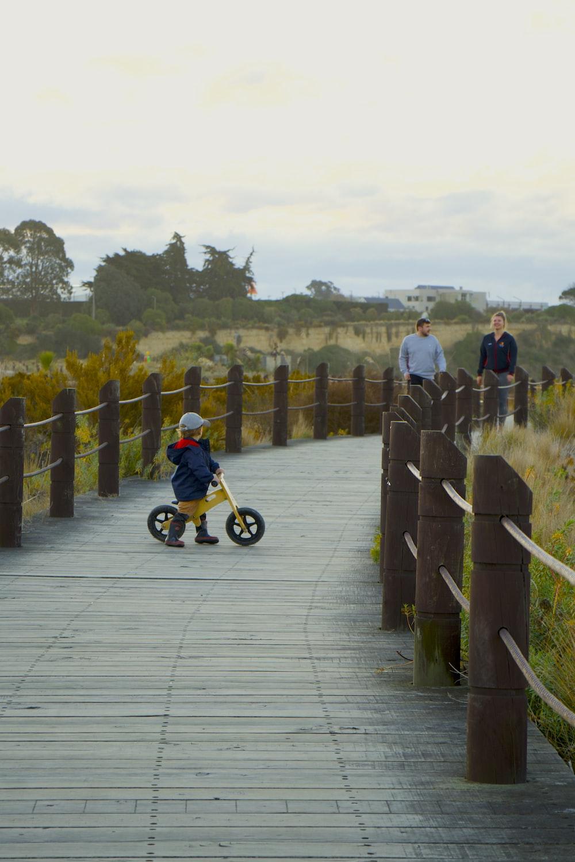 boy playing balance bike