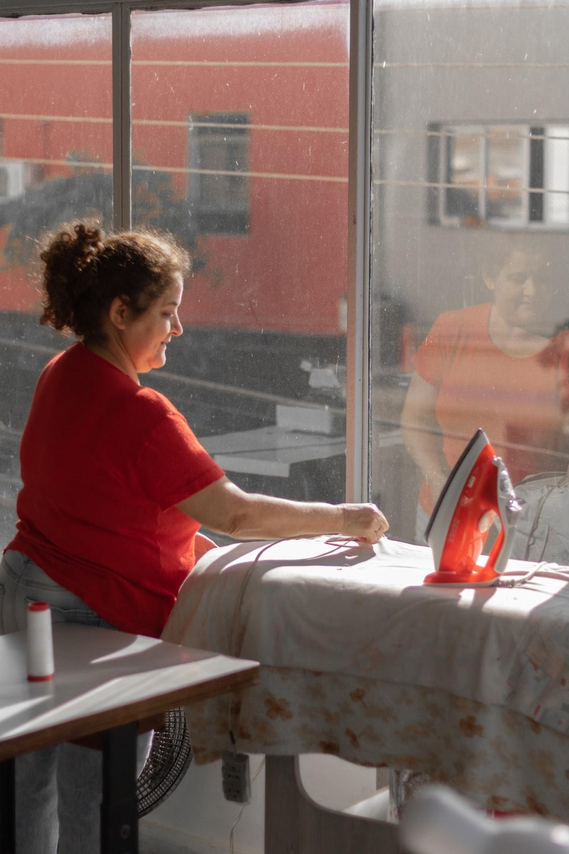 woman sitting near steam iron