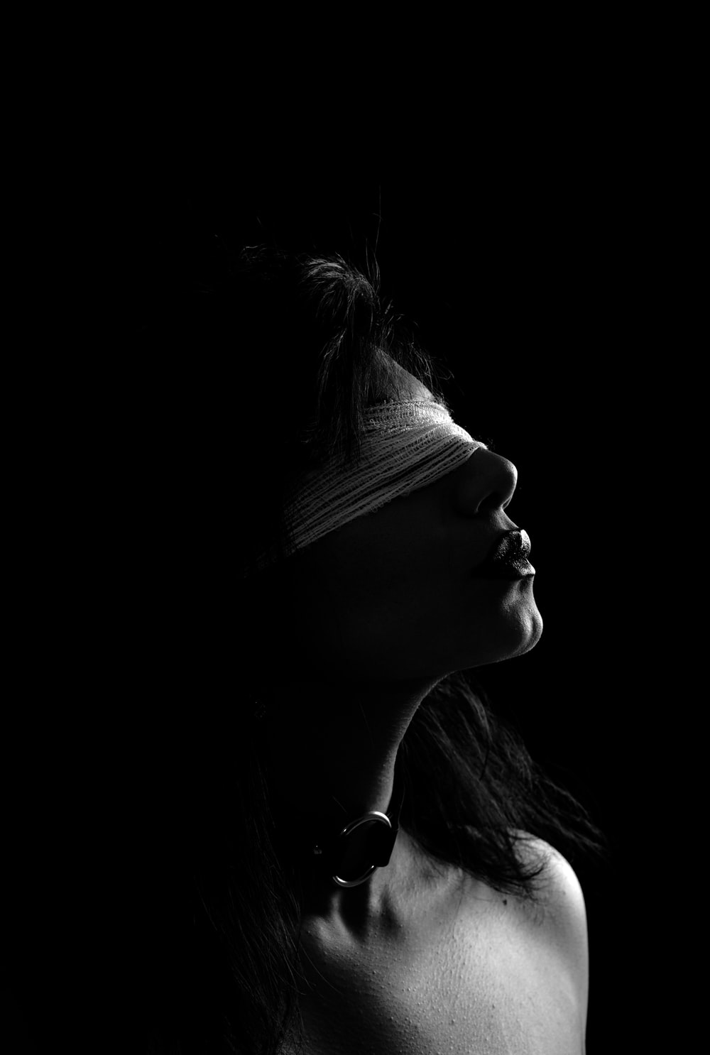 grayscale photography of woman wearing blindfold