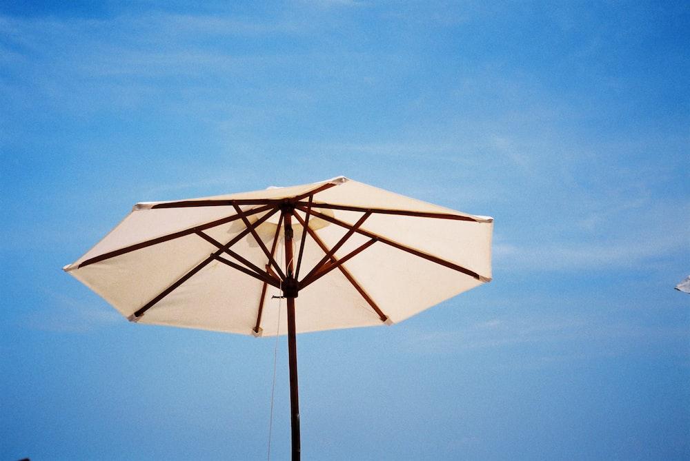 white and brown umbrella