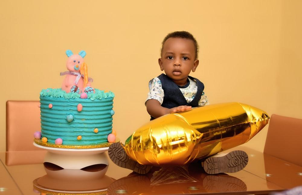 baby beside cake