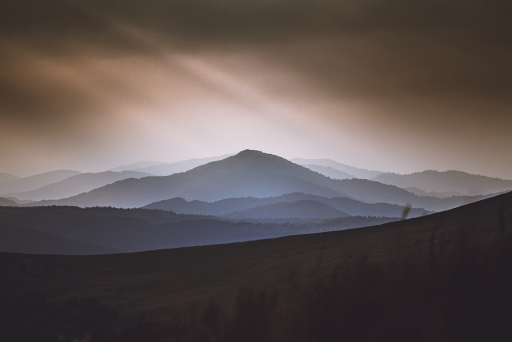 silhouette of mountains and dark clouds