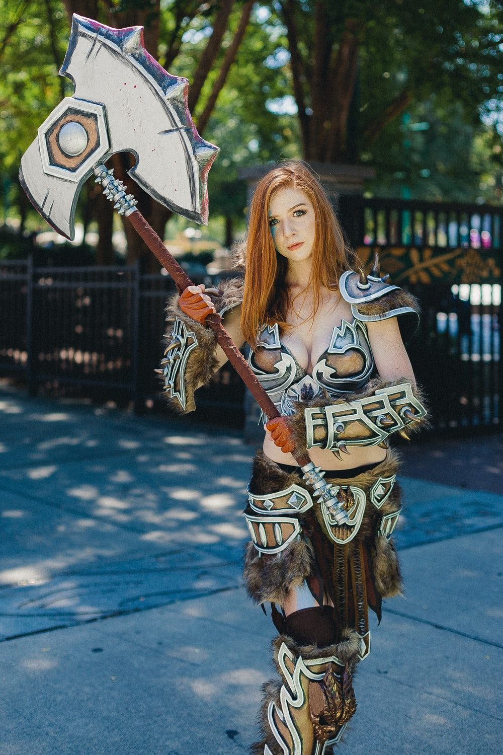 woman with cosplay costume holding swor