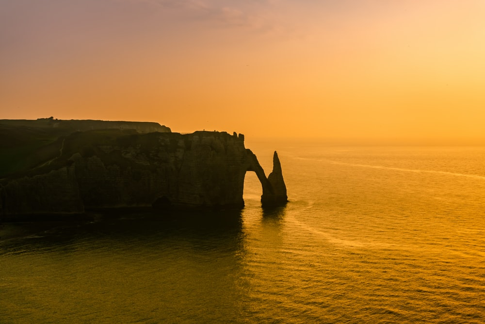 rock formation on the ocean photography