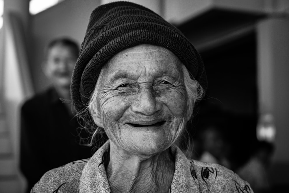 gray-scale photo of woman wearing knit cap