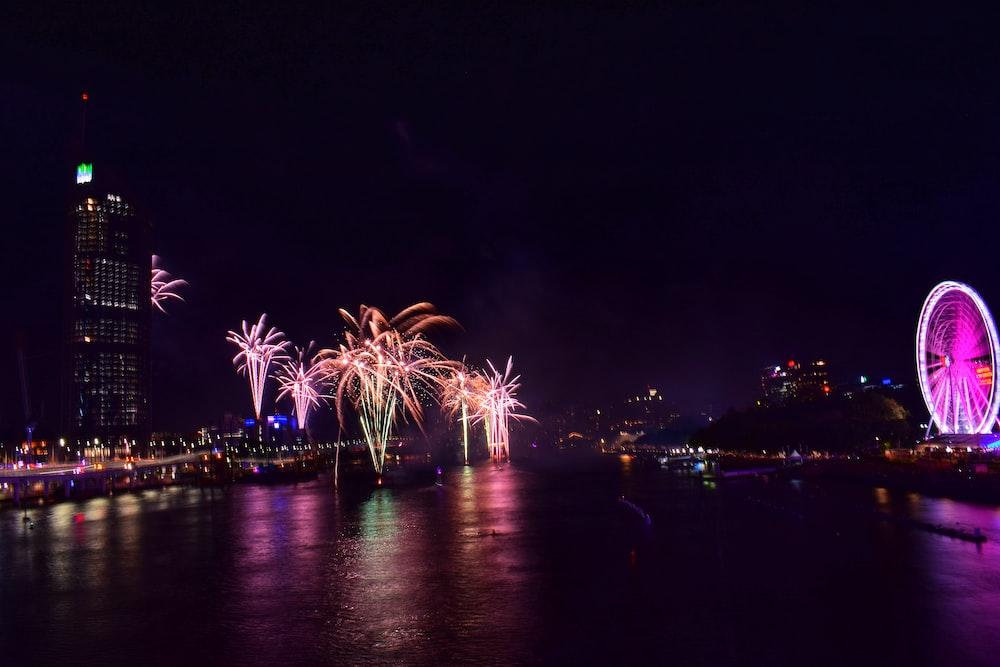 white, pink, and orange fireworks at nighttime